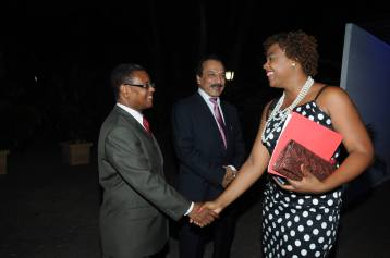 Shanoy Coombs meeting UNAIDS Representative, Dr. Somes